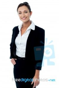 confident-female-executive-posing-100329782