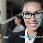 smile-business-woman-100278059